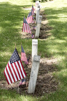 Cemetery Tombstones Marked with American Flags